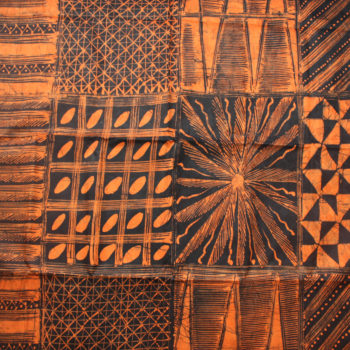Orange and black batik fabric