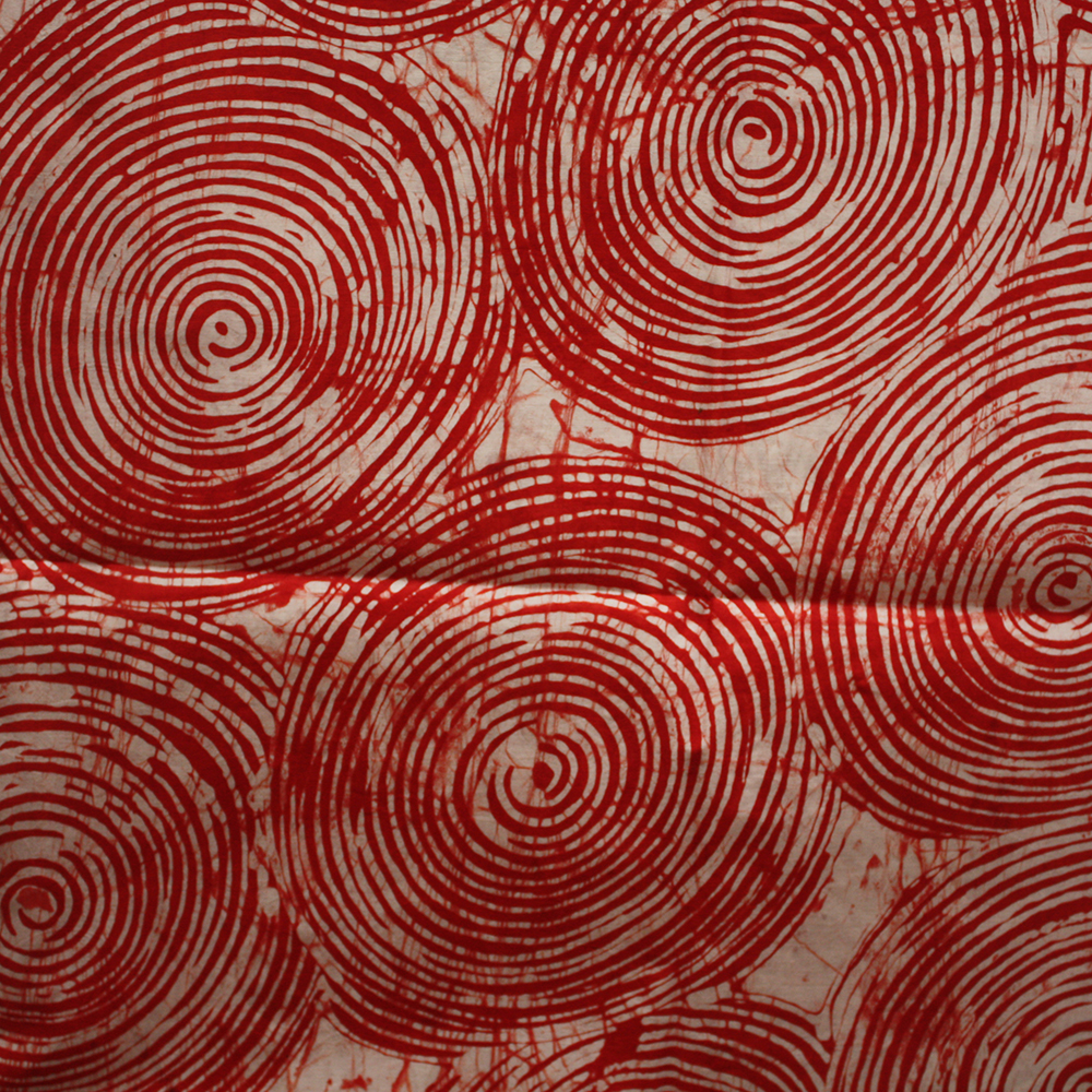 Red circles batik fabric from Urbanstax online fabric store