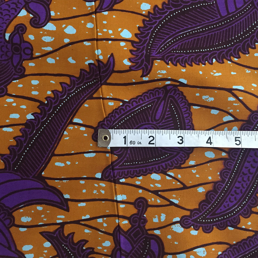 Burnt orange and purple African wax print
